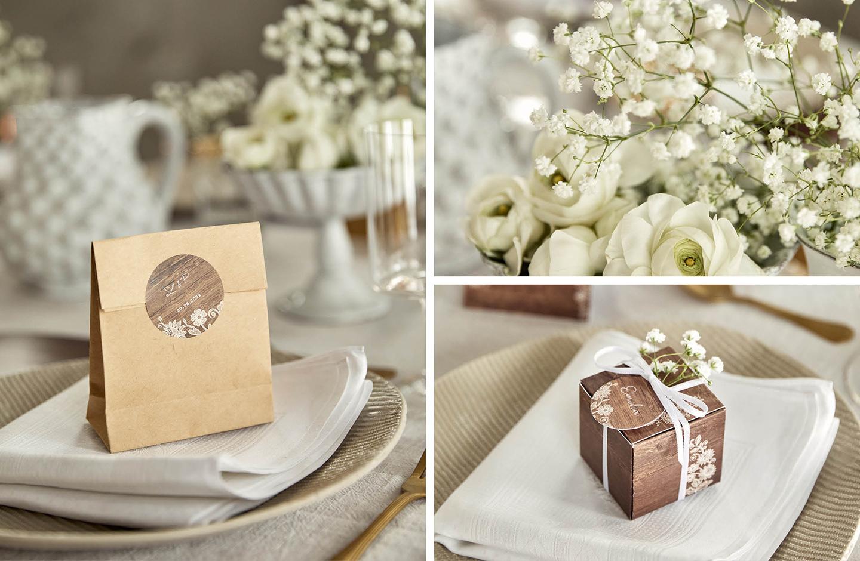 Geschenktüten und Geschenkboxen für Gastgeschenke, dekoriert auf der Hochzeitstafel
