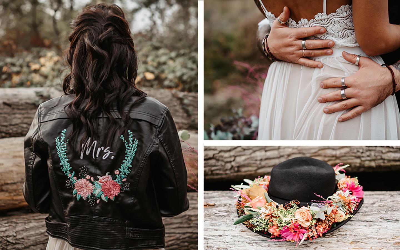 Braut Details: Lederjacke in schwarz mit bunter Blumen-Bestickung. Hut mit Blumenkranz und Kleid aus weißer Spitze