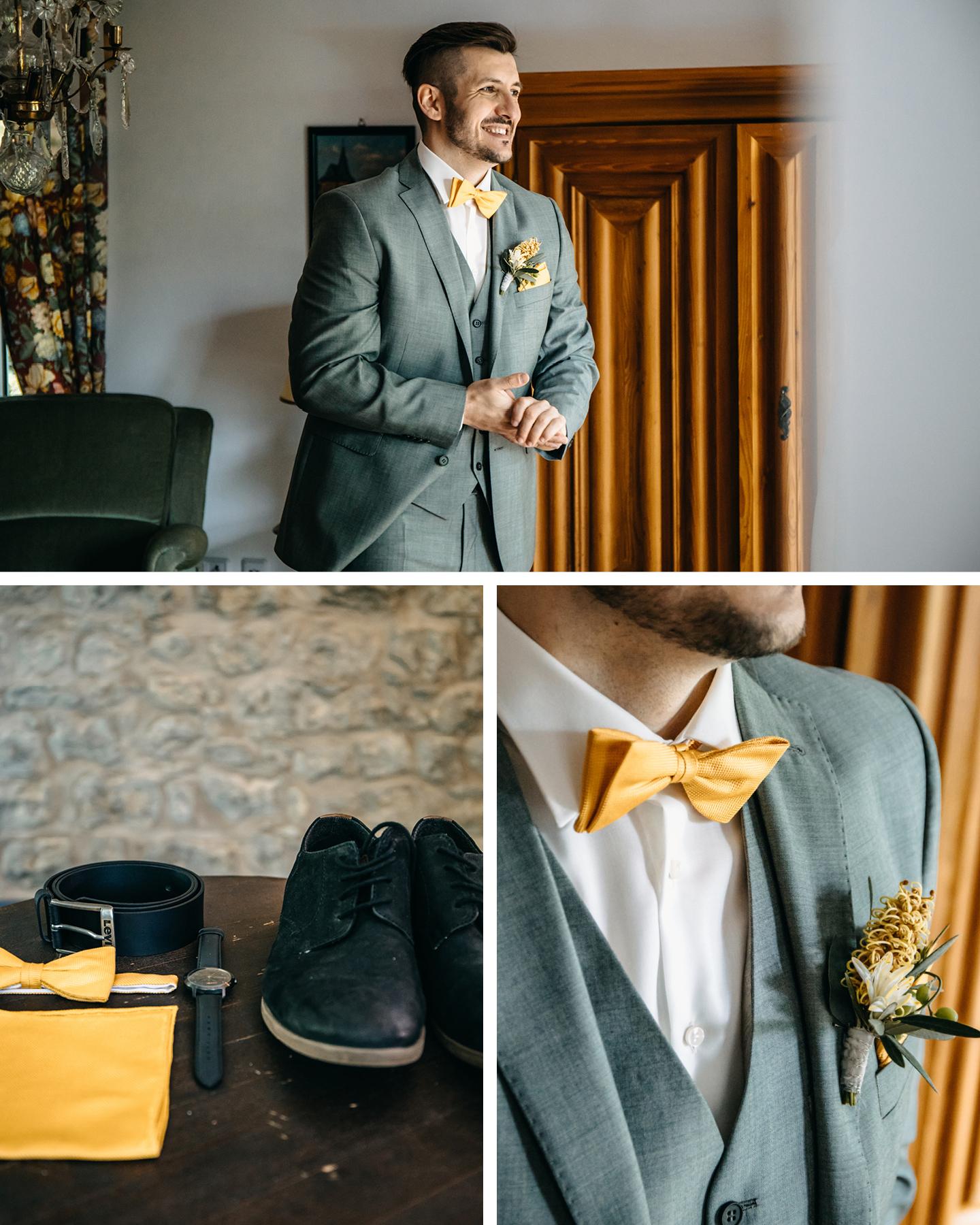 Heiraten Weingut: Bräutigam macht sich fertig für die Hochzeit und legt gelbe Fliege und gelbe Ansteckblumen an.