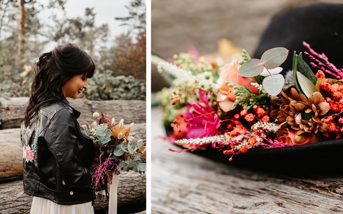 Die Braut hält den Brautstrauß aus bunten, leuchtenden Blumen in orange, pink und rostigen Tönen.
