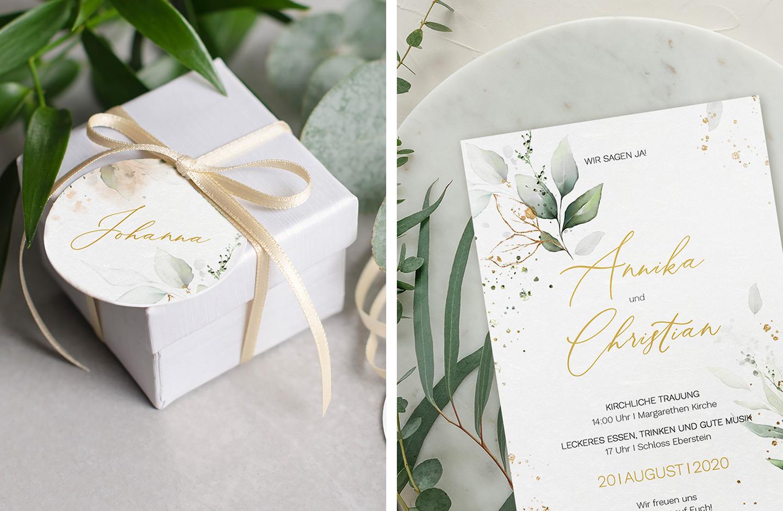 Anhänger mit grünen Blätter-Illustrationen ist an weiße Geschenkbox geknotet.