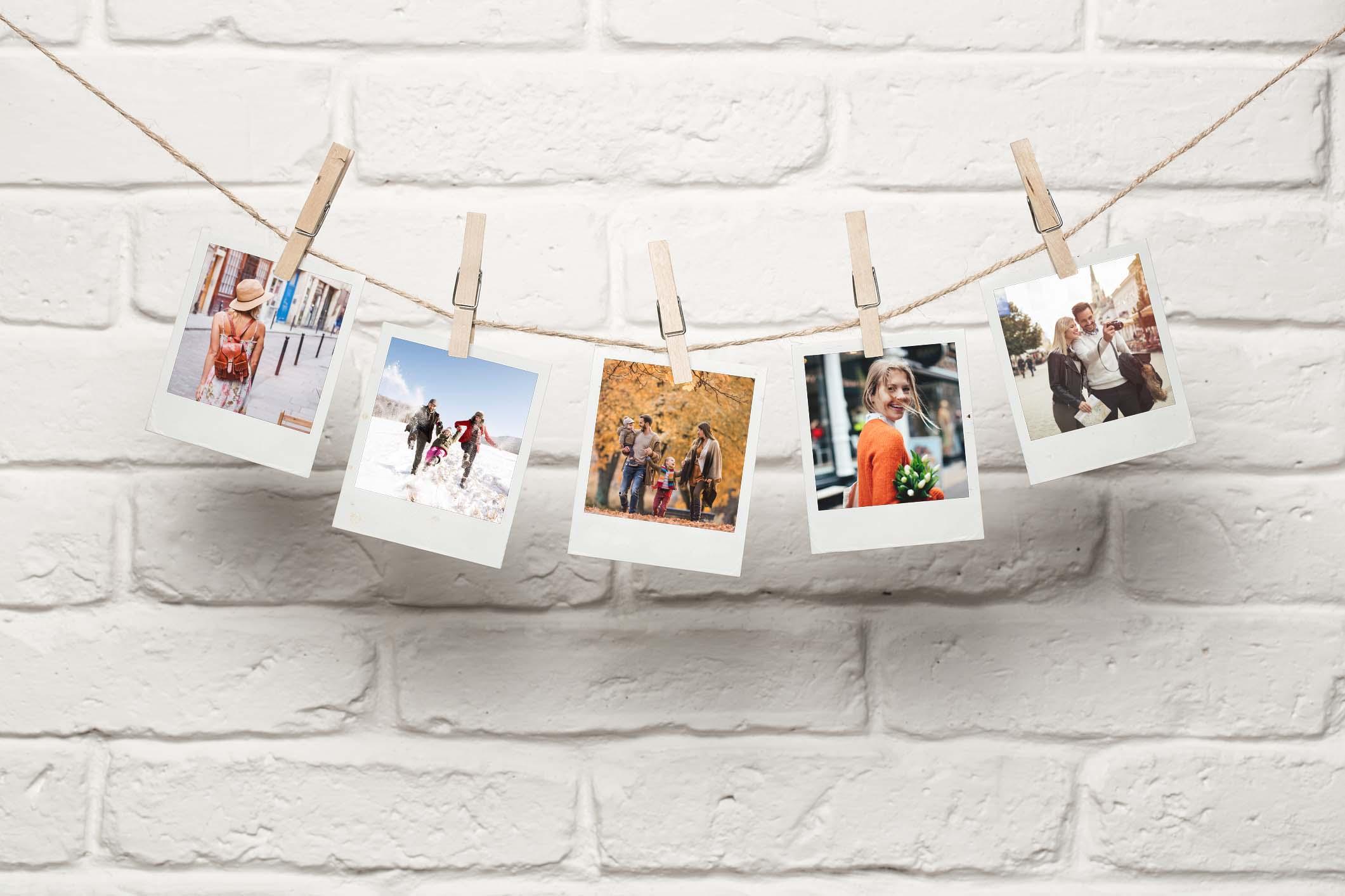 Fotos an Girlande aufgehängt als Fotogeschenke Idee