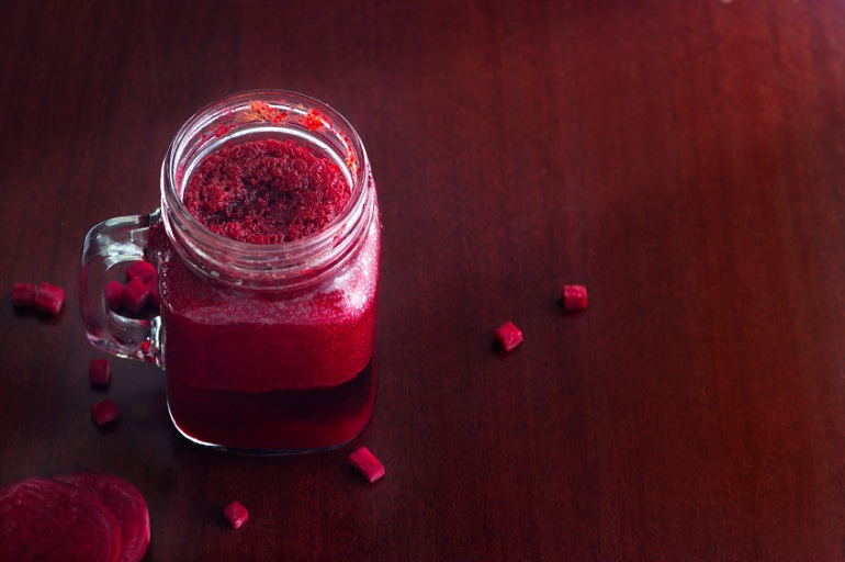 Beetroot smoothie healthy and herb on wooden table background, P
