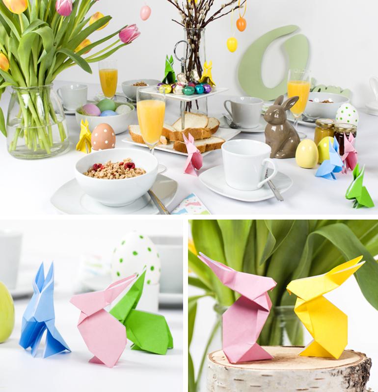 gedeckter Ostertisch dekoriert mit selbstgebastelten Origami Osterhäschen aus Papier in bunten frühlingshaften Farben.