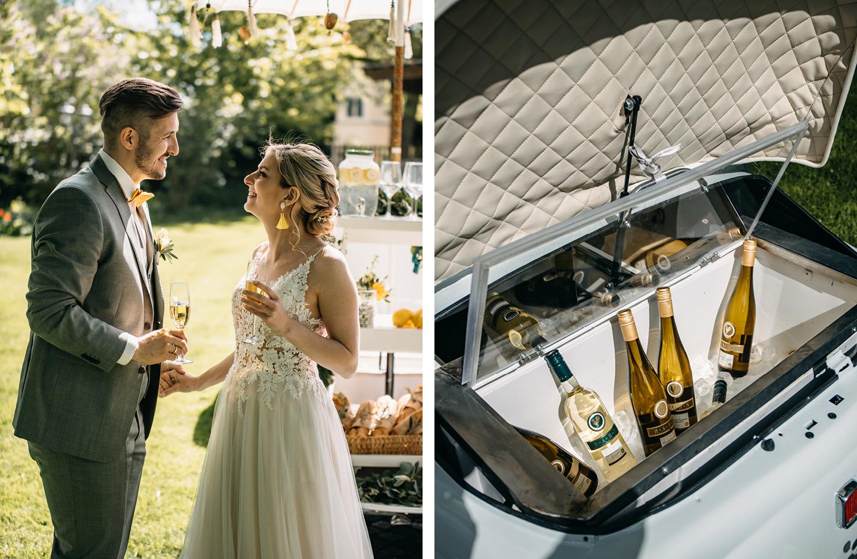 Hochzeitspaar stößt mit Sekt an auf ihren Hochzeitstag im Weingut.