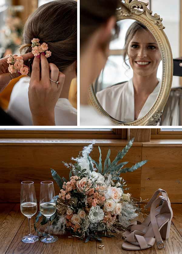 Details der Boho Braut: Brautstrauß mit Wildblumen, zarte Schuhe in Rosé und sanftes Make-Up.
